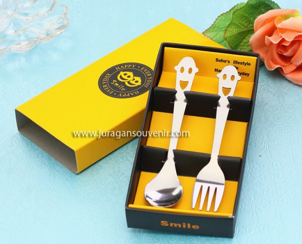 Yellow smiley cartridge fork spoon