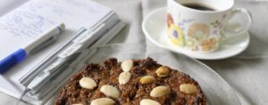 cropped fruit cake and note book