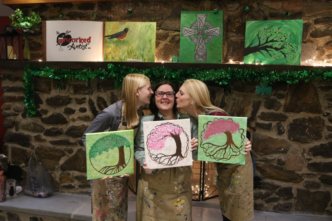 my girl friends and I with our finished tree of life paintings and acting silly