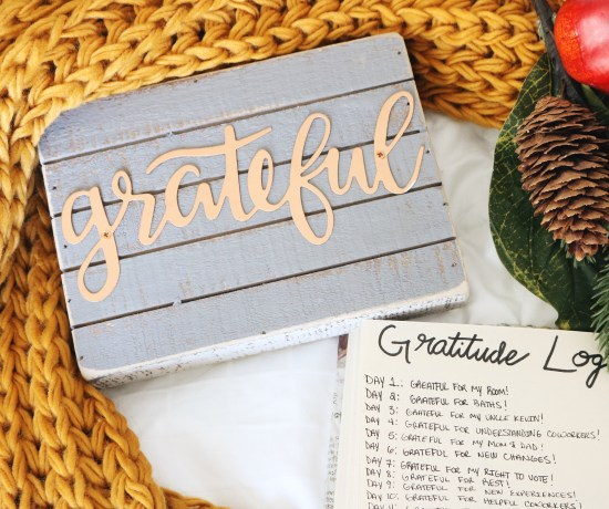 photo of a grateful sign with a mustard knit scarf around it