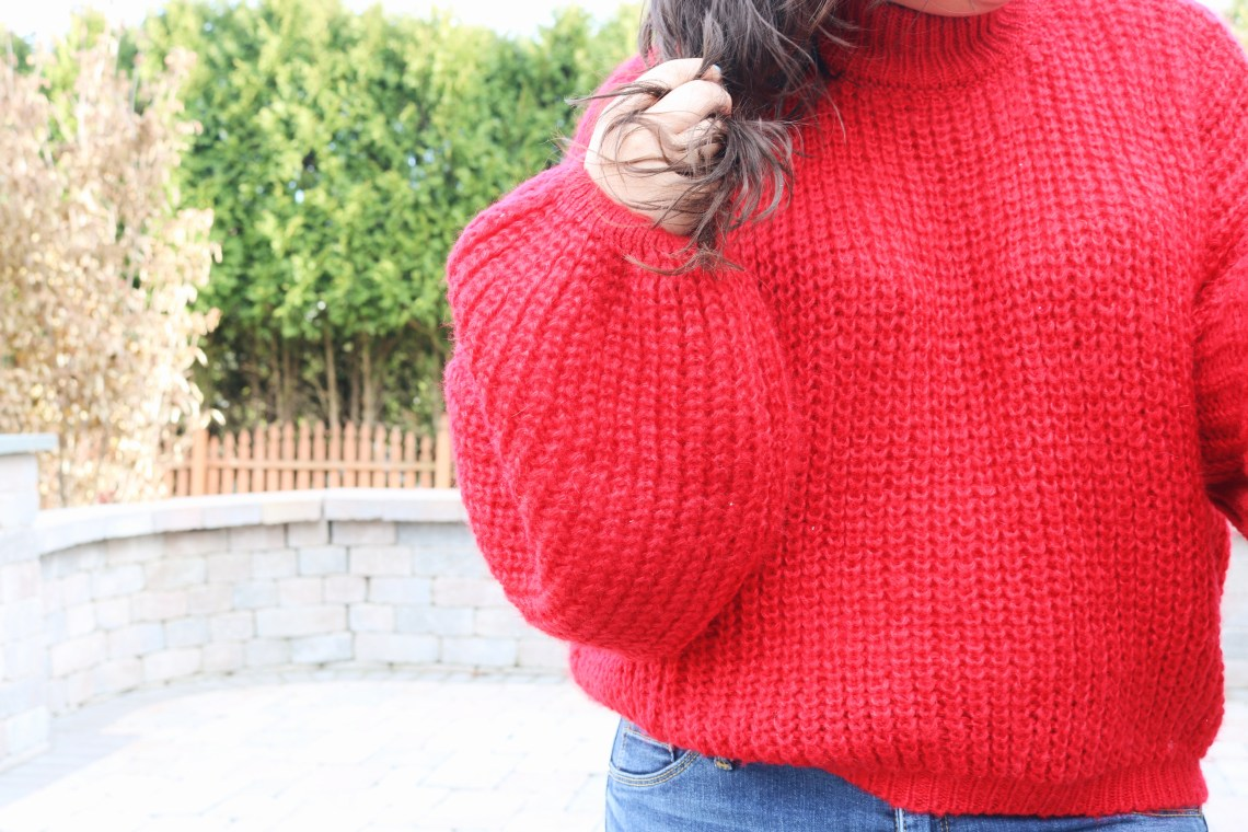 Me holding my hair and close up of red sweater