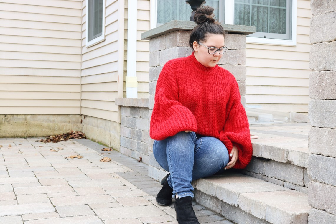 Me sitting down on patio step in my red sweater