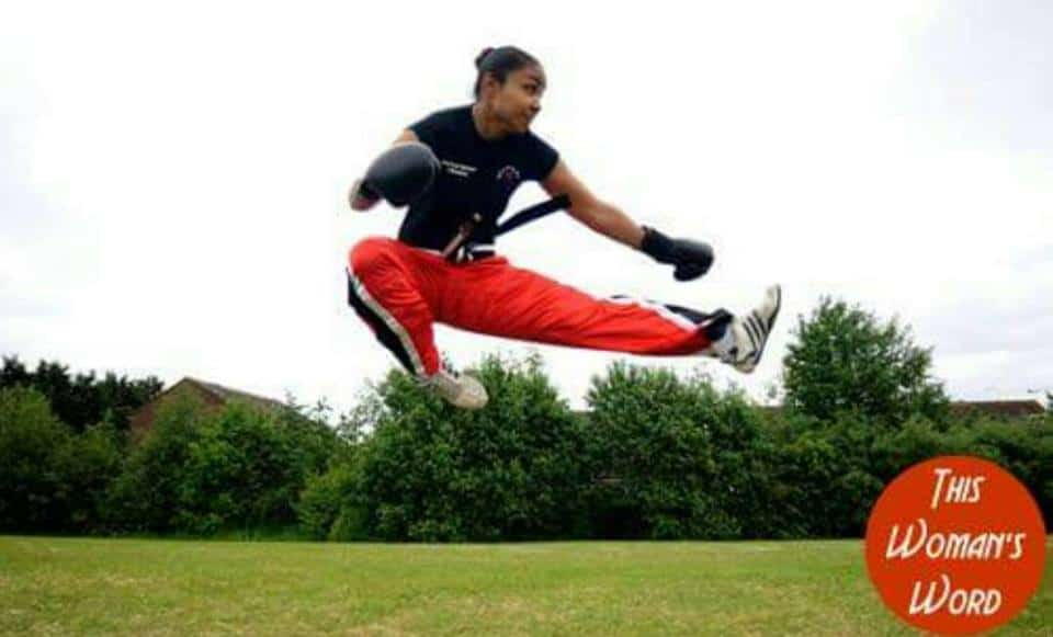 Lady in the air in a kickboxing pose about a metre from the ground!