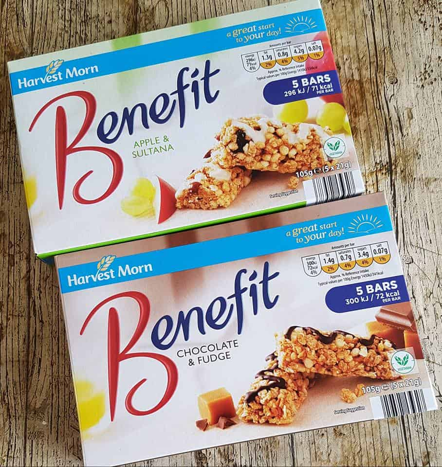 Two boxes of Benefit bars (cereal bars) one chocolate and fudge flavour the other apple and sultana flavour