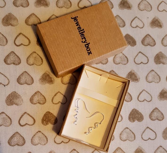 earings in a brown box
