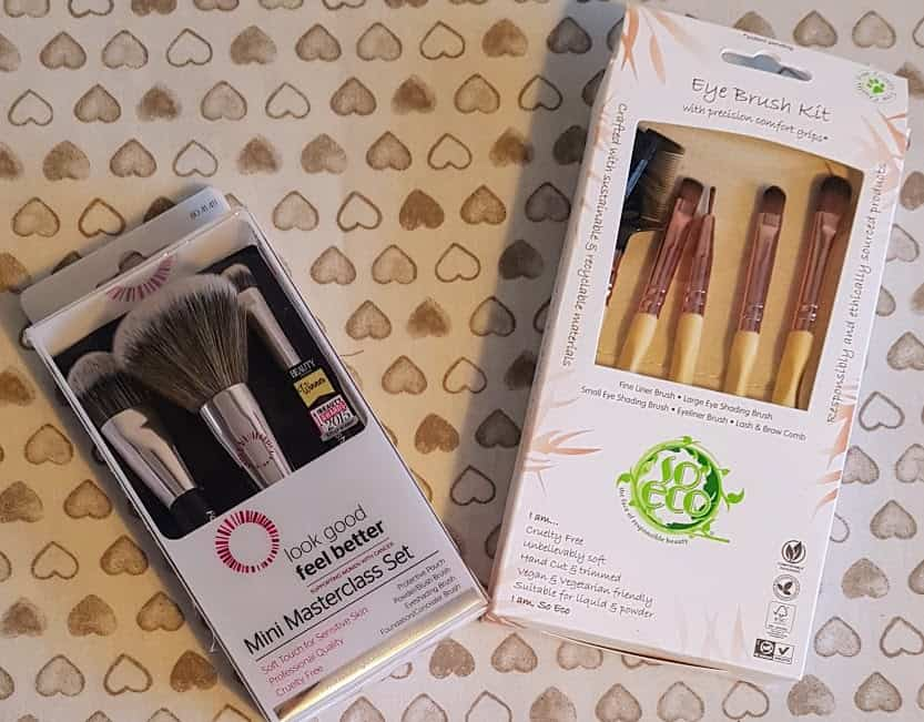 two boxes of make up brushes