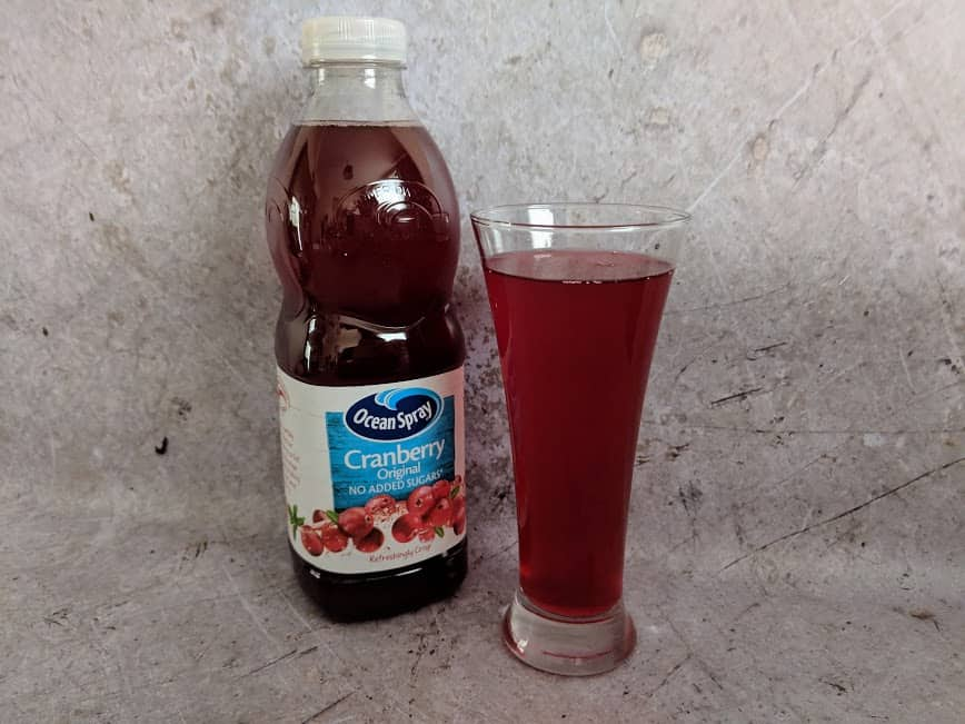 ocean spray cranberry juice bottle and glass