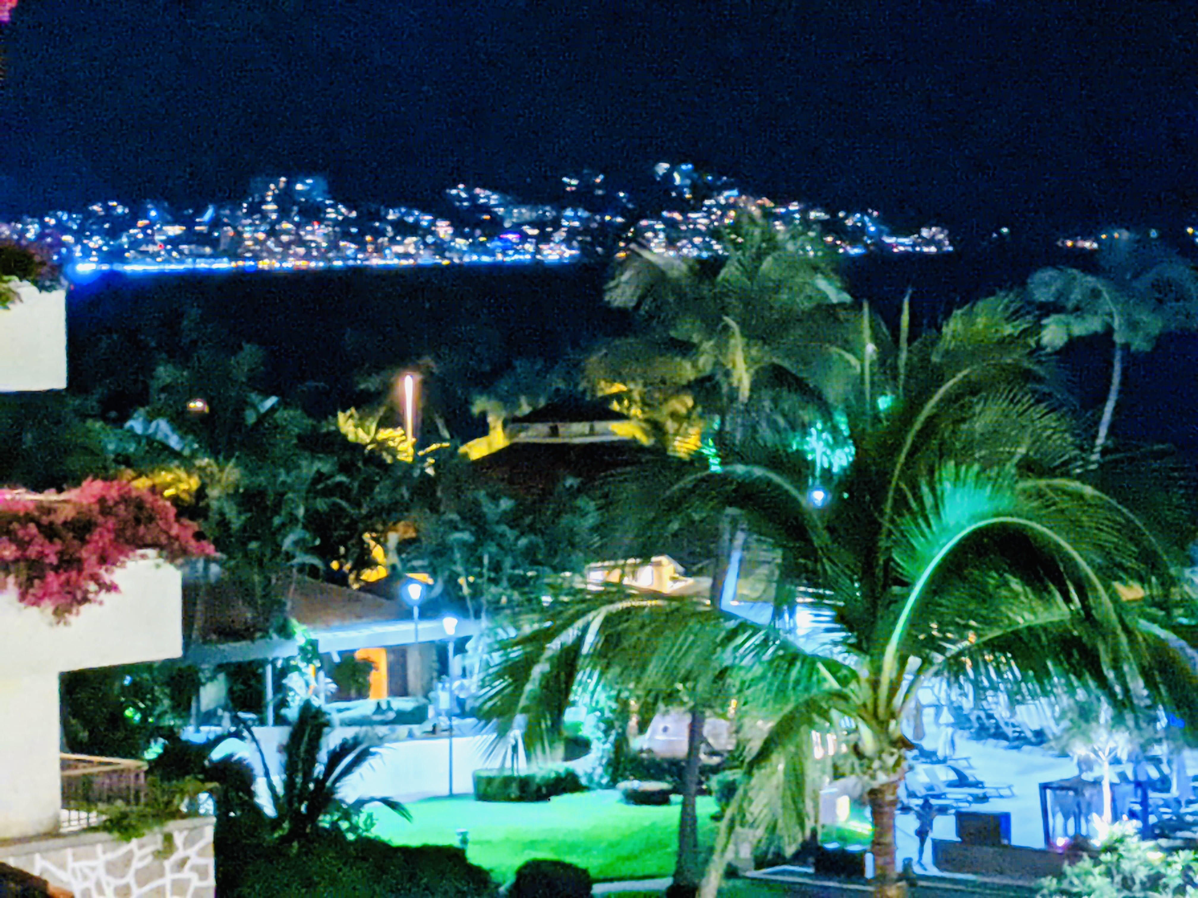 View from our terrace at the Marriott, of the oceans, mountains, and the pool area at night
