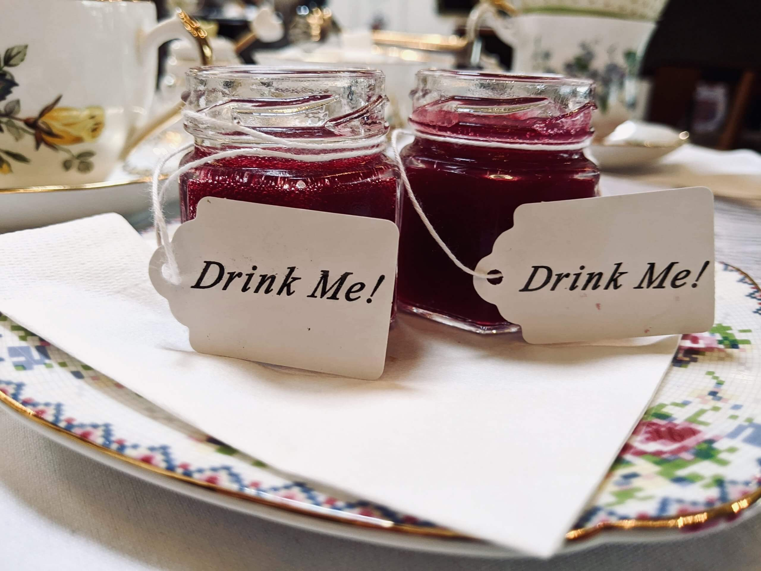 The chilled beet soup in tiny bottles that say Drink Me on them