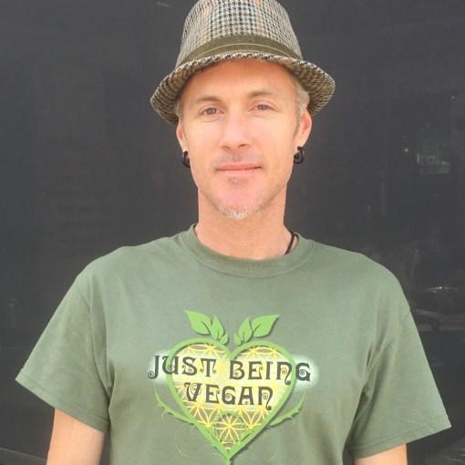 Photo of Jalen in Just Being Vegan sacred Heart Logo-T-shirt