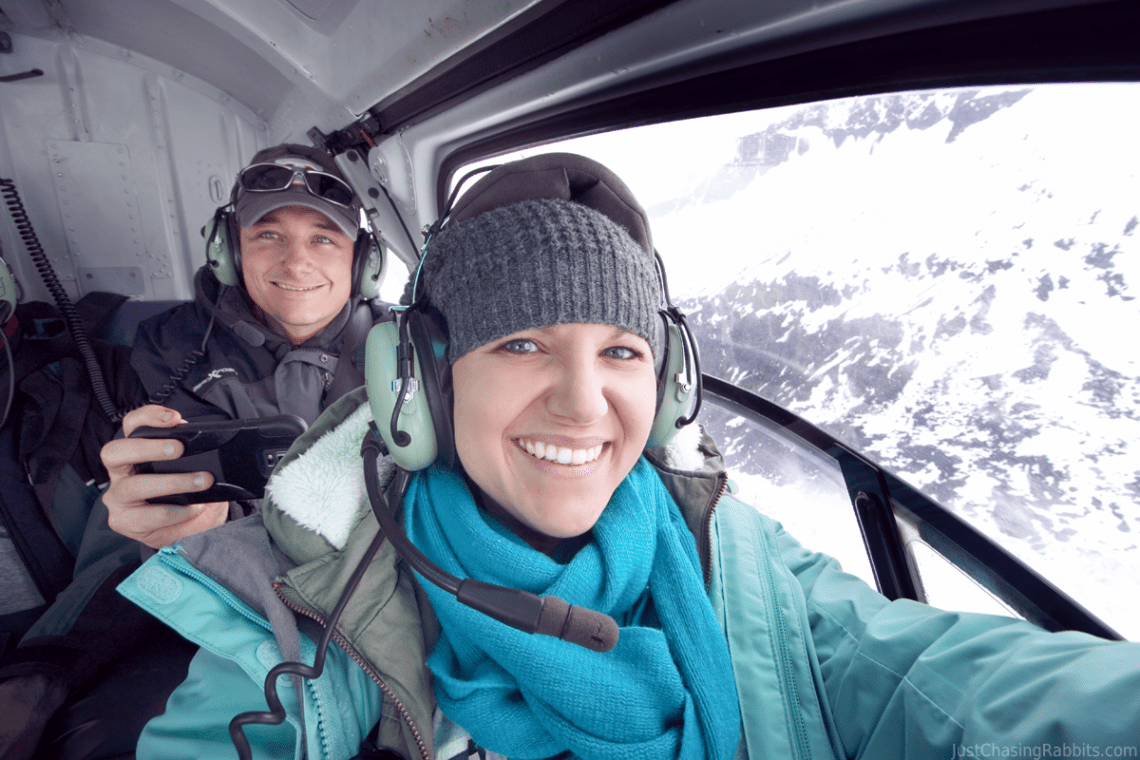 Jenni and Mark in a helicopter over Herbert Glacier in Juneau, Alaska.