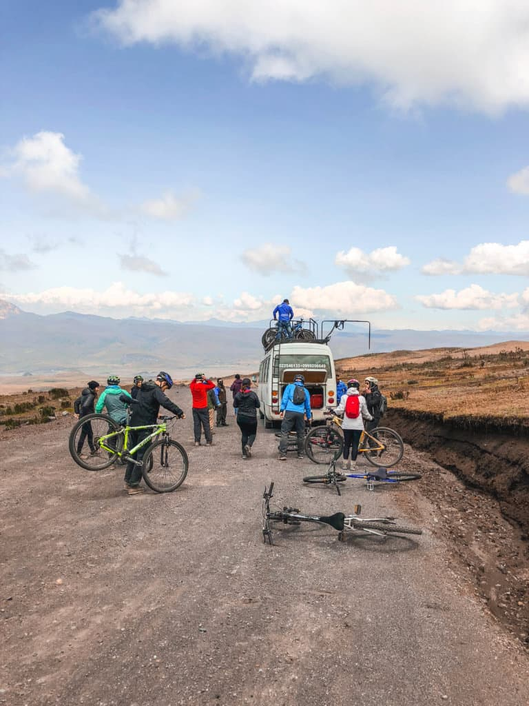 The van and people getting the mountain bikes