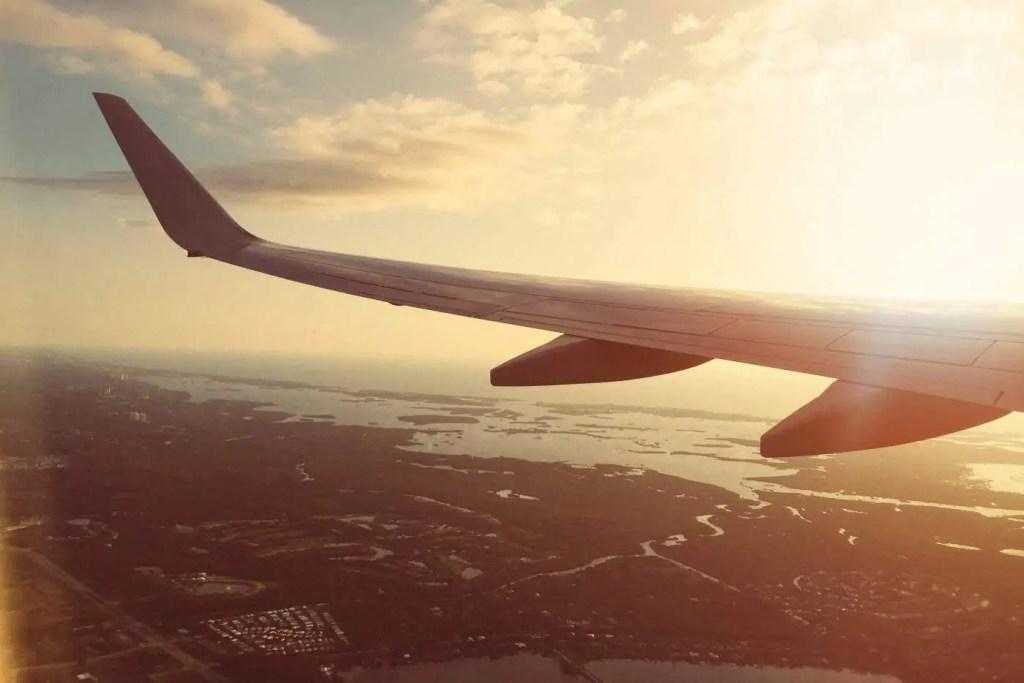 plane wing at sunset
