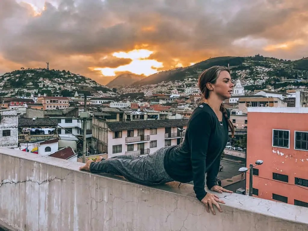 Me doing yoga at sunset in Quito