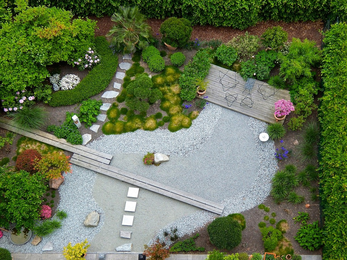 Why not design a mini getaway on your own homestead and create something totally different, like maybe a  Zen Garden?