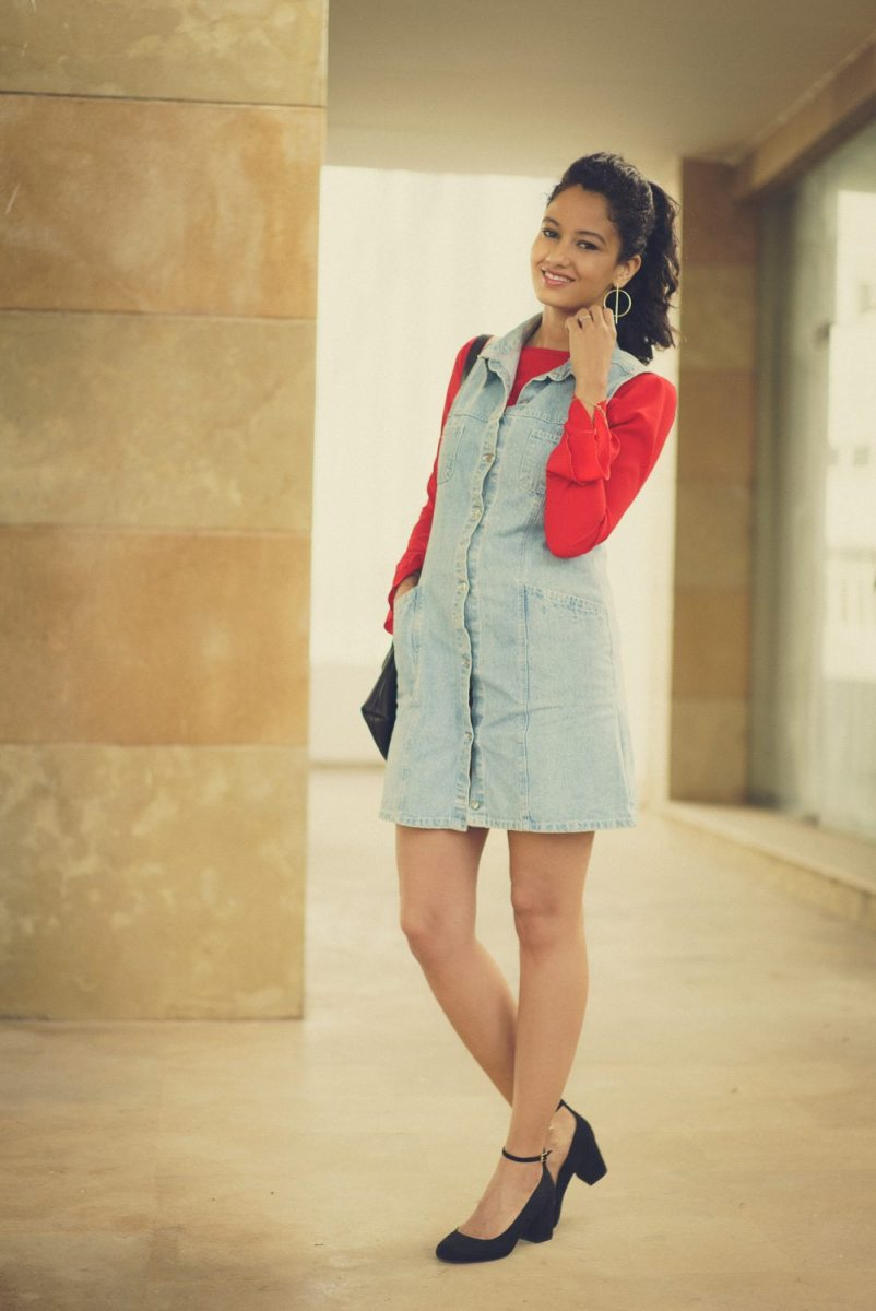 Spring layers: denim dress and red ruffle sleeves