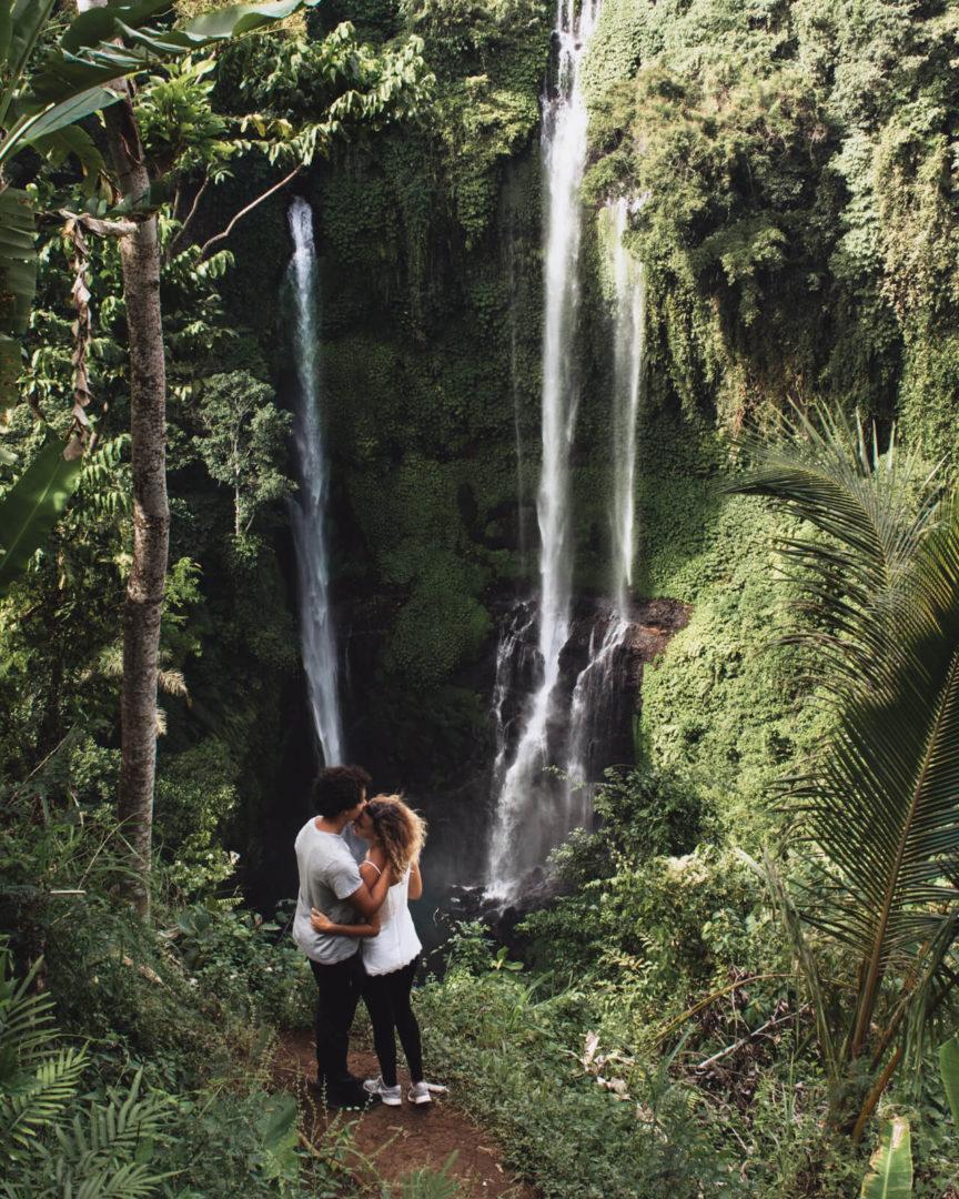 Couple hike to the top of sekumpul waterfall kissing