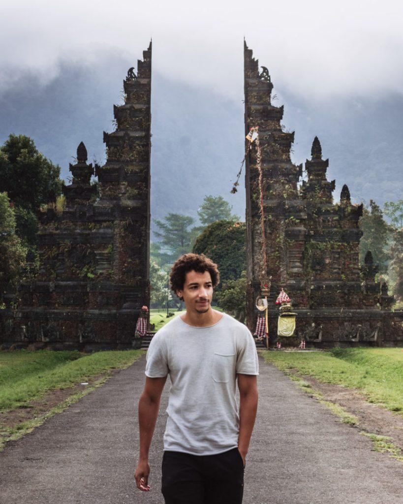 Man outside Bali gate in Munduk