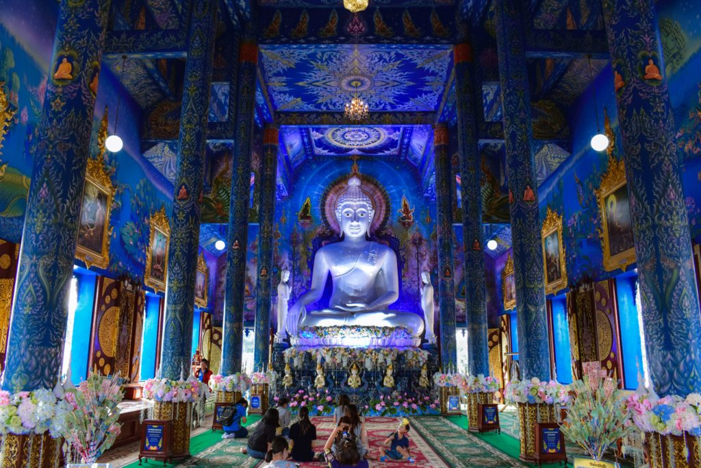 Blue Temple Chiang Rai Interior, big white Buddha statue