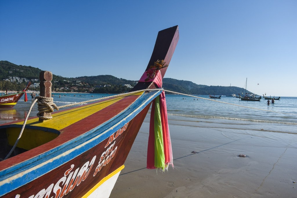 Colourful paint and cloth on long-tail boat