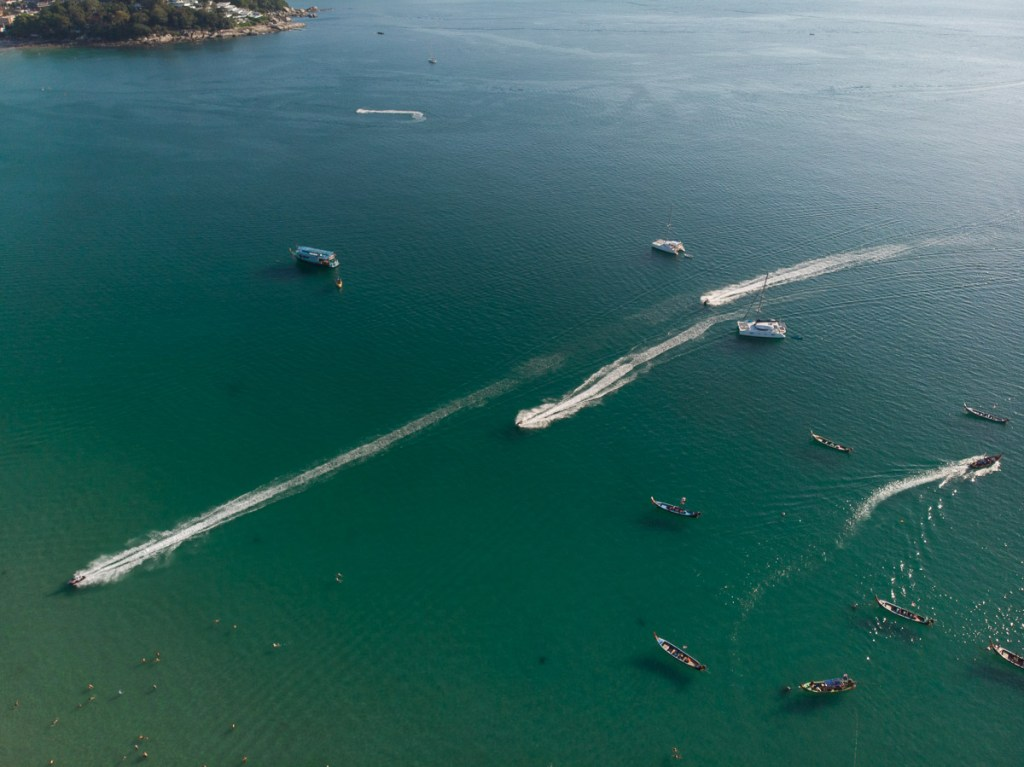 drone shot of jet skis and long-tail boats on Kata ocean