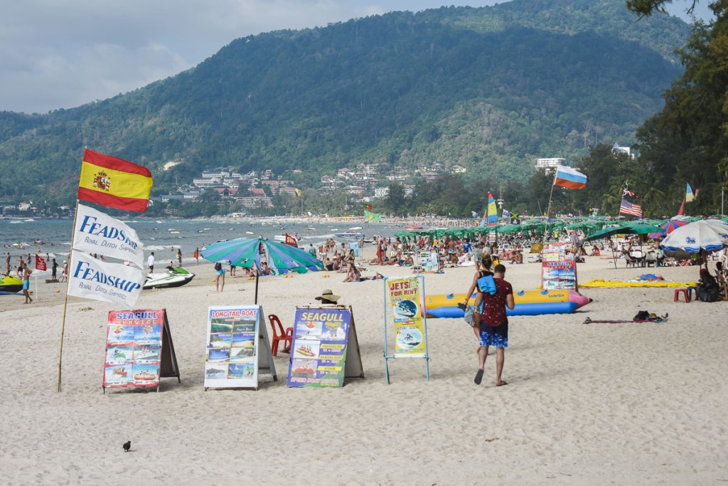Beach activity signs on Patong beach for tourists