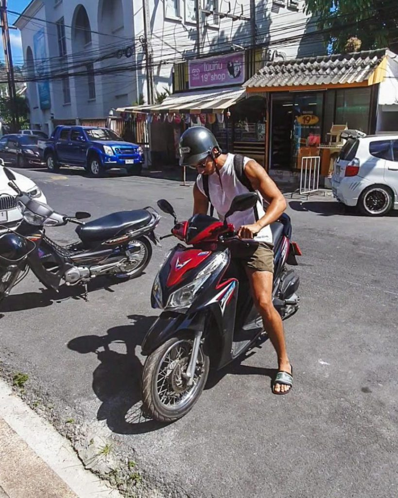 Woody renting a scooter in thailand