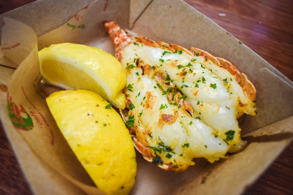lobster tail and lemon wedge