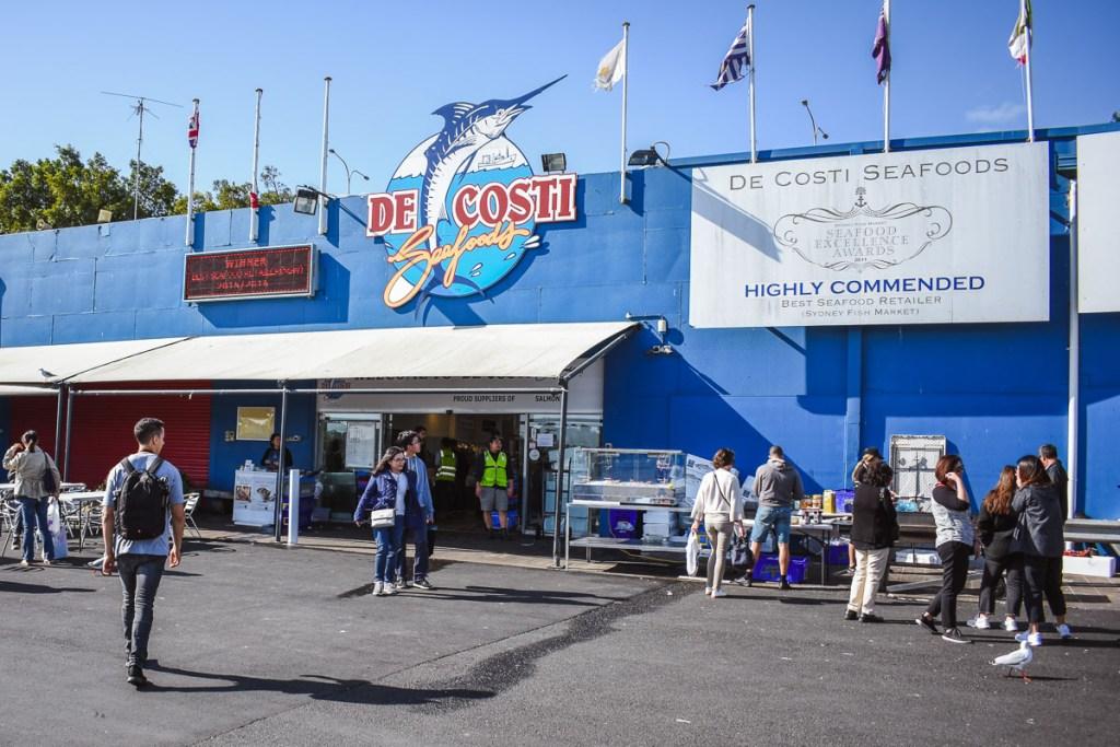 de costi seafood sign