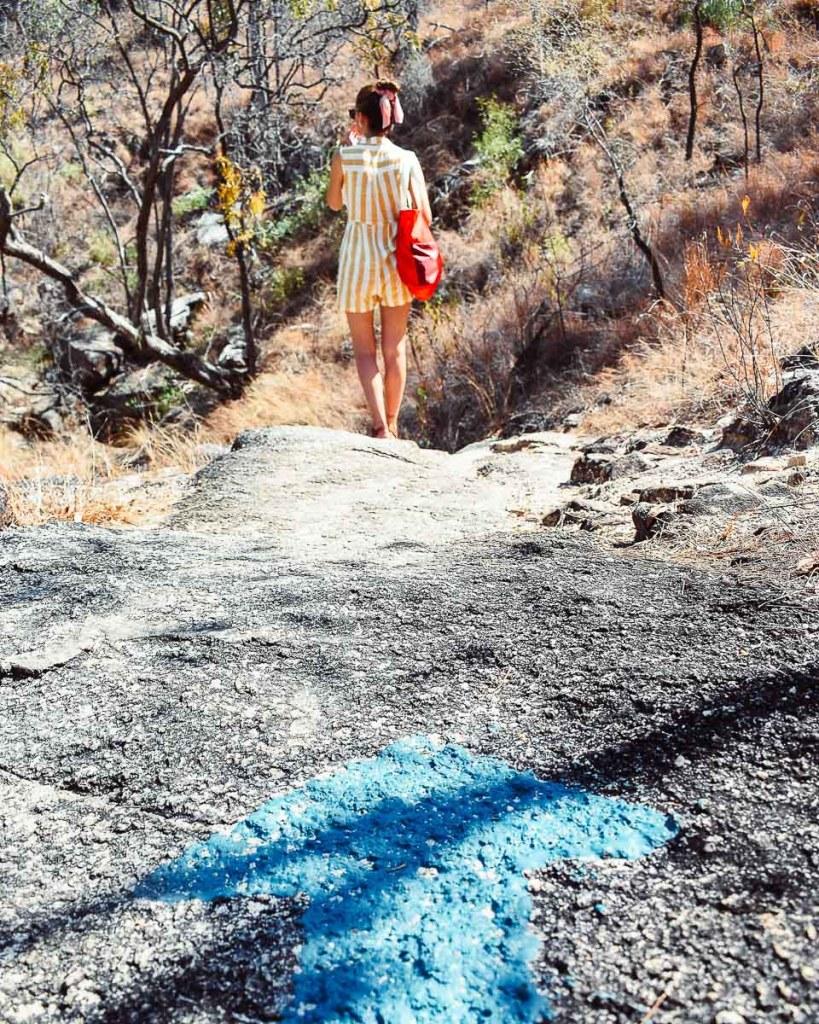 Kerrie following blue arrow directions on Emerald Falls walking hike