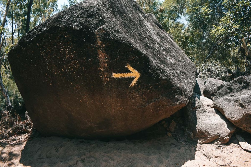 Yellow arrows on boulders at Granite Gorge