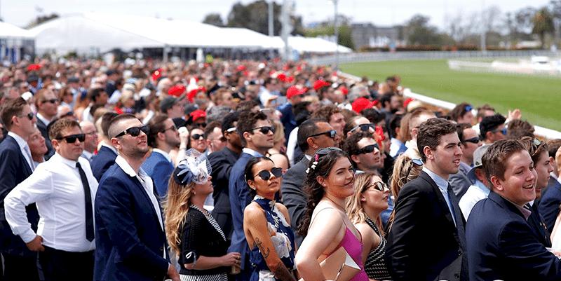 caulfield cup crowd looks on horse racing