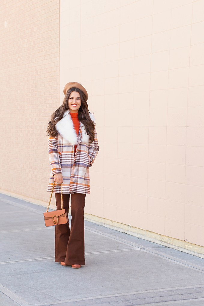 Winter 2019 Lookbook | Apres Ski: A fun, 70's Inspired Look | How to Style Flared Jeans for Winter | A plaid coat with a faux fr collar styled with an orange knit sweater, brown flared jeans, velvet ankle booties and a Brown Gucci Dionysus Small Shoulder Bag | Bohemian Winter Style Ideas | How to Wear the 70's Trend in 2019 | Calgary, Alberta, Canada Fashion & Lifestyle Blogger // JustineCelina.com