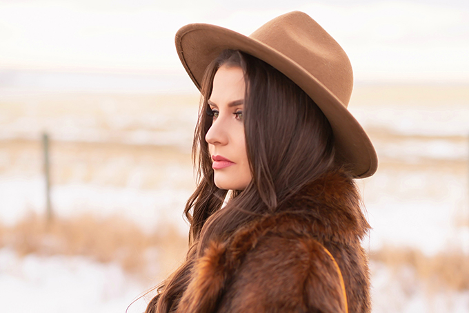 Pre Spring 2019 Trend Guide Bohemian Rhapsody: How to Style Midi Dresses for Transitional Spring Weather | Brunette Girl Standing in a Country Field at Sunrise Wearing a Brown Faux Fur Coat and Brown Wide Brim Hat | Bohemian Early Spring Style Ideas | Pantone Spring Summer 2019 Fashion Ideas | Calgary, Alberta, Canada Fashion & Lifestyle Blogger // JustineCelina.com