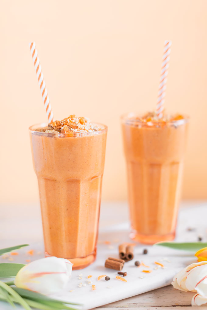 Vegan Cardamon Carrot Cake Smoothie | healthy carrot cake smoothie, cardamom carrot cake smoothie recipe, cardamom carrot cake smoothie vegan, cardamom carrot cake smoothie image, cardamom carrot cake smoothies, paleo carrot cake smoothie, vegan paleo carrot cake smoothie, the best vegan carrot cake smoothie, 2 carrot cake smoothies with spring tulips against a creamsicle orange pastel background and a marble serving board | Calgary, Alberta Creative Lifestyle Blogger // JustineCelina.com