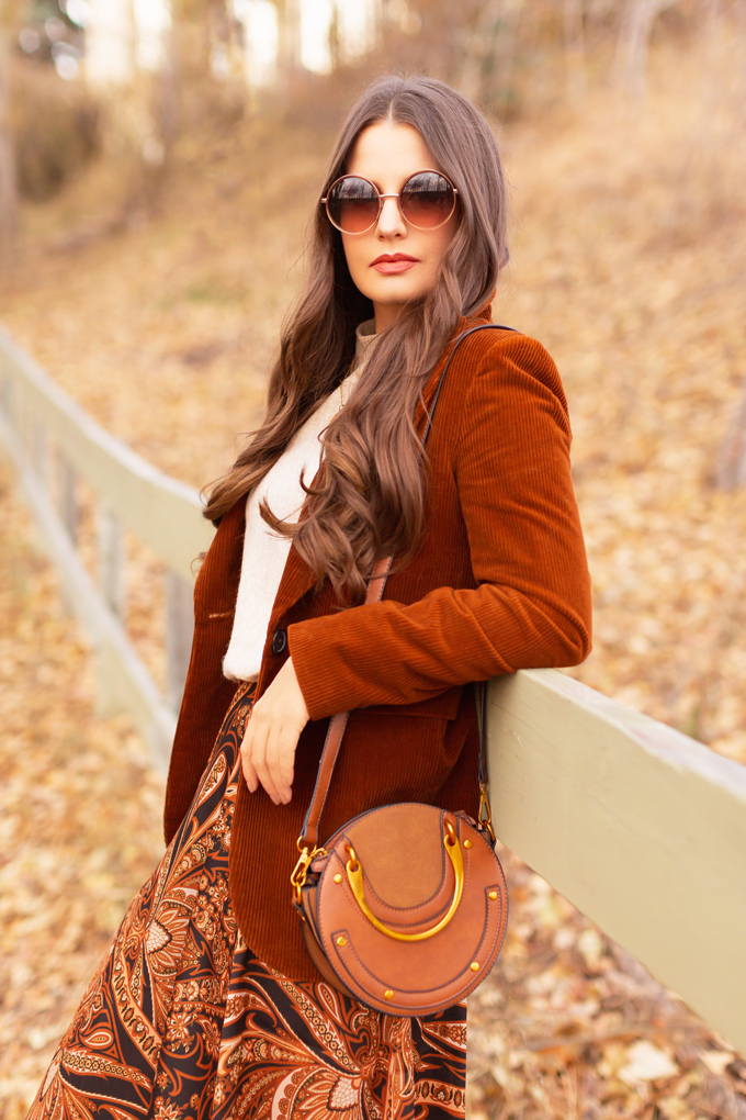 Autumn 2019 Lookbook: Equestrian Influence   Top Fall / Winter 2019 Trends   Top Autumn 2019 Trends and How to Wear Them   H&M x Richard Allen Collection Review   Brunette woman wearing H&M x Richard Allen Skirt with Belt, Cognac Corduroy Blazer, H&M Fine Knit Swearer in Beige and Lucky Brand Azoola Boots surrounded by fall leaves   Bohemian Fall / Winter 2019 Outfits   How to Style Paisley   How to Style Corduroy Top Calgary Fashion & Creative Lifestyle Blogger // JustineCelina.com