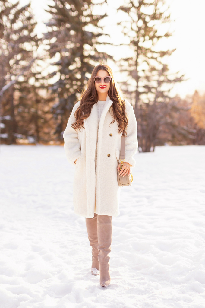 Autumn / Winter 2019 Lookbook: Winter Whites | Top Fall / Winter 2019 / 2020 Trends | Top Winter 2019 Trends and How to Wear Them | Brunette woman wearing a Mango Oversized Cream Teddy Coat, Cream Cable Knit Sweater Dress, Grey Over The Knee Boots and Grey Chloe Tess Dupe | Monochromatic Cream / White Outfit | Festive Winter Holiday Outfit | Christmas Dinner Outfit | Canadian Winter Outfit Ideas | Fenty Stunna Lip Paint in Uncensored | Top Calgary Fashion & Lifestyle Blogger // JustineCelina.com
