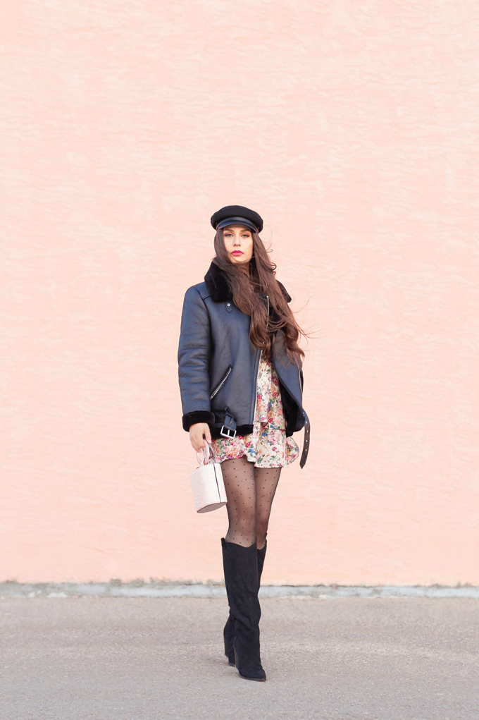 WINTER / SPRING 2020 LOOKBOOK | Rebel Florals | Brunette woman wearing a Zara Full Sleeve Print Dress with a Faux Fur Lined Black Biker Jacket, Black Faux Leather Brimmed Baker Boy Hat, Blush Croc Embossed Bag | Black Circular Sunglasses, Sheer Polka Dot Tights an H&M Black Faux Suede Knee-high Boots | Top Transitional Winter to Spring 2020 Trends | Canadian Winter / Spring Lookbook | How to Wear Spring 2020's Mini Dress | Transitional Winter to Spring Fashion for Canadians // JustineCelina.com