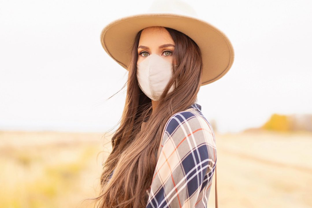Early Autumn 2020 Lookbook | Country Checks | Brunette woman wearing a taupe flat brimmed fedora, a taupe, orange and navy blue plaid dress and a tan duponi silk non-medical face mask | Boho Fall 2020 Outfit Ideas | Top Fall 2020 Trends | Thanksgiving Outfit Idea | Bohemian Fall outfit | Plaid Outfit Ideas | The Best Non-Medical Silk Face Masks | How to coordinate your face mask to your outfit | Cottagecore Fall Outfit Ideas | Calgary Alberta Fashion & Lifestyle Blogger // JustineCelina.com