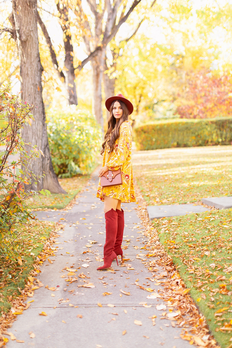 Early Autumn 2020 Lookbook | Mindful Mustard | Brunette woman wearing a rust fedora, a mustard yellow botanical print shift dress, rust knee high western boots and a cognac croc-embossed bag on a sunny autumn afternoon | warm weather fall outfit ideas | Fall 2020 Trend Guide | Casual Fall Fashion | Boho Fall 2020 Outfit Ideas | Fall in Calgary | Transitional Summer Meets Autumn Fashion | Fall Photoshoo Ideas | Calgary Alberta Fashion & Lifestyle Blogger // JustineCelina.com