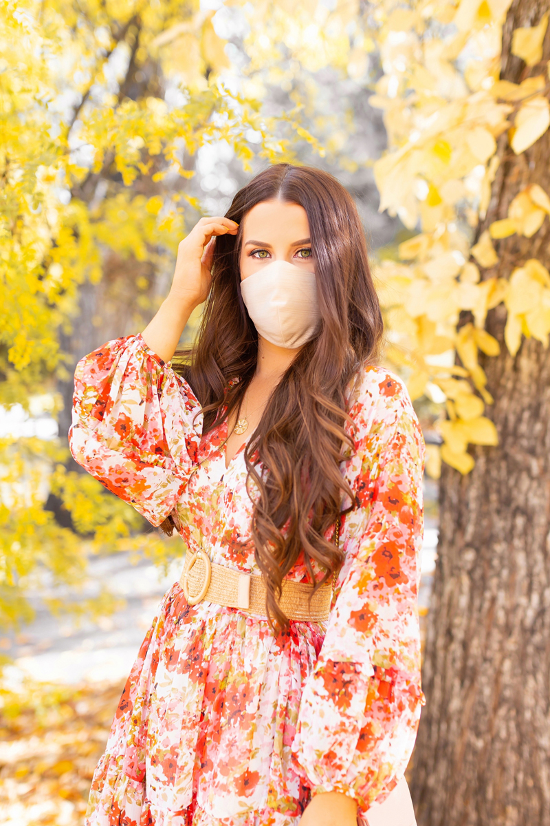 Early Autumn 2020 Lookbook | Brunette woman wearing a fall floral dress with statement sleeves and a rattan belt with a Katie May Collection Champagne Glow Up Face Mask | Boho Fall 2020 Outfit Ideas | Fall in Calgary | the best formal face masks 2020 | Triple layer formal face masks with a filter | Katie May Collection Facemask Review | Where to Buy Fabric Facemasks in Calgary | How to Style your Face mask to match your outfit | Calgary Alberta Fashion & Lifestyle Blogger // JustineCelina.com