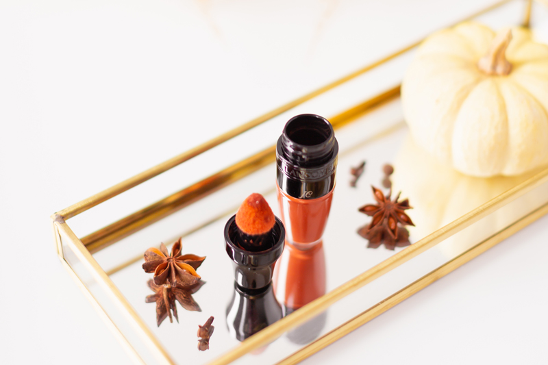 My Top 5 Pumpkin Spice Lipsticks | JustineCelina's favourite fall lipsticks | The Best Pumpkin Spice Lipsticks for Fall | Fall 2020 Lipstick Trends | Lancôme Matte Shaker High Pigment Liquid Lipstick in Abrick Adabra Photos Review Swatches | The Best Luxury Fall Lipsticks | The Best Pumpkin Spice Lipsticks for Fall | Monogrammed lipstick on a Mirrored Tray with spices, a white mini pumpkin and pampas grass in the background // JustineCelina.com