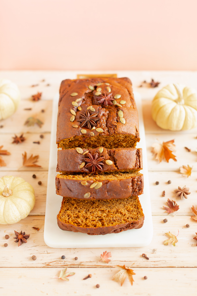 Gluten Free Mapled Pumpkin Chai Bread   Sliced Pumpkin Bread on a Marble Serving Board, served on 2 pink plates with gold forks and a chai latte   Chai Spice Bread styled with spices and white mini pumpkins arranged on blush pink barn board backdrop   Easy Pumpkin Bread   Moist Pumpkin Bread   The Best Gluten Free Fall Baking Recipes   No Sugar Pumpkin Bread   Maple Syrup Pumpkin Bread   Pumpkin Bread Cake   Healthy Pumpkin Bread   Calgary Plant Based Food Blogger // JustineCelina.com