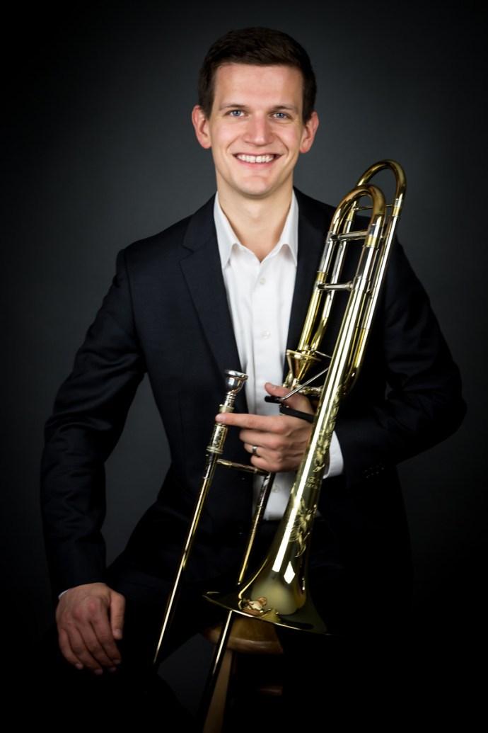 Headshot of Justin Moore, trombonist.
