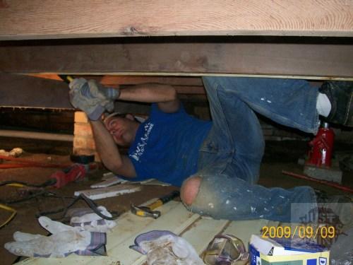 Cracked and sagging floor joists in random spots under the bedrooms.