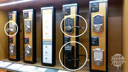 Home Depot display of keypad levers and automatic keyless deadbolts.