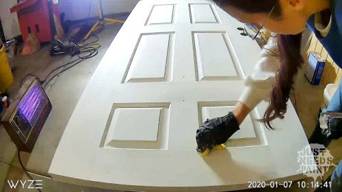 Overlapping painting steps: each step begins with a last glance from the last step. No paint brush here! One last sand and wipe down of the door before painting.