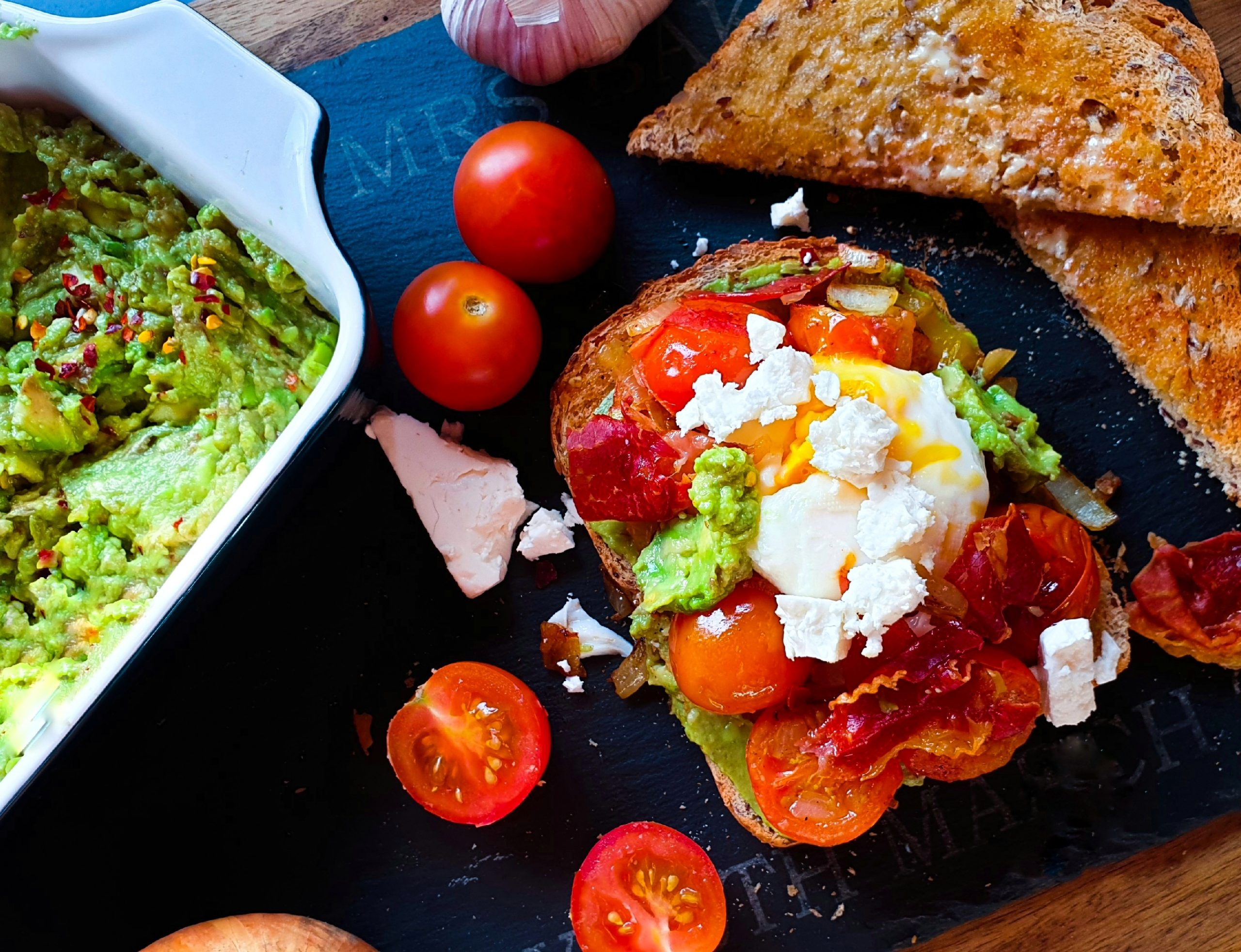 Spiced avocado smash with bacon, egg and feta