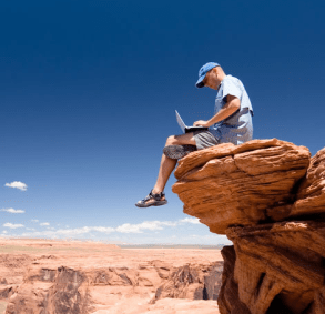 Working from a laptop on a rock