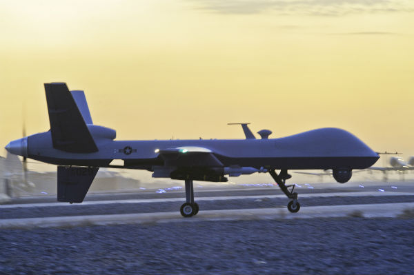 "A 2009 US Air Force photo titled ""ready to hunt"" shows an armed American MQ-9 Reaper drone taxiing in Kandahar, Afghanistan."